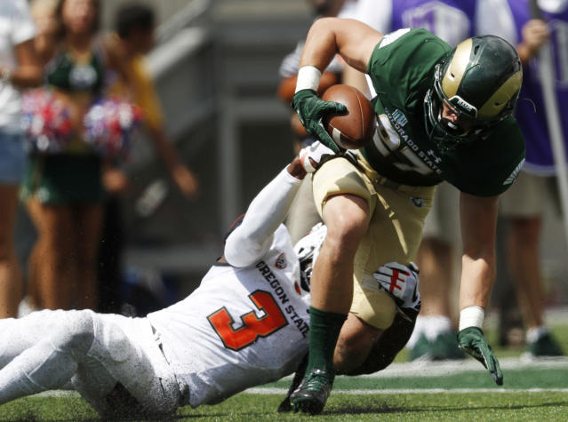 """Colorado State wide receiver <a class=""""link rapid-noclick-resp"""" href=""""/ncaaf/players/254473/"""" data-ylk=""""slk:Trey Smith"""">Trey Smith</a> has two catches in the first half. (AP Photo/David Zalubowski)"""
