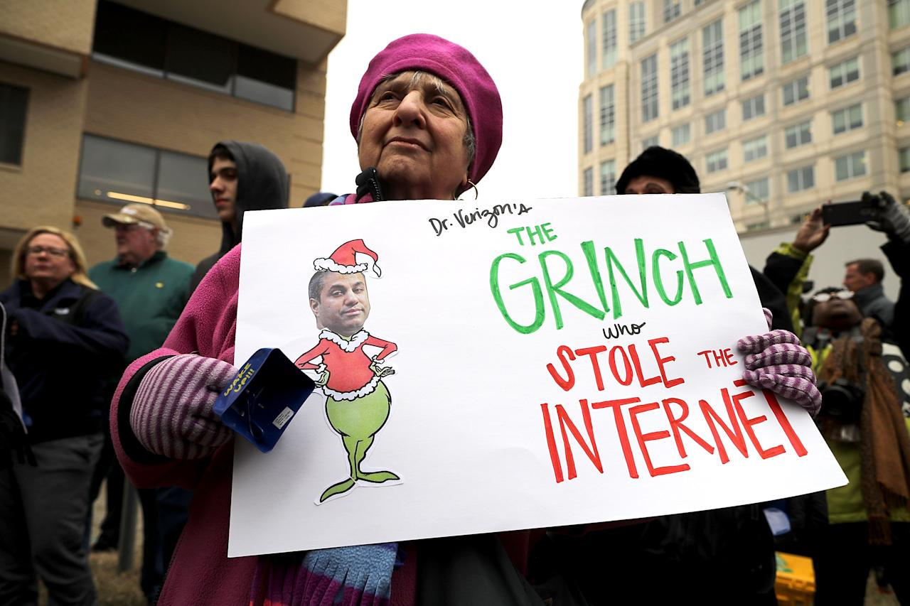 <p>Demonstrators rally outside the Federal Communication Commission building to protest against the end of net neutrality rules, Dec.14, 2017 in Washington. (Photo: Chip Somodevilla/Getty Images) </p>
