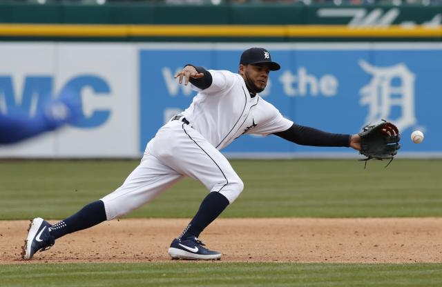 Detroit Tigers third baseman Jeimer Candelario fields the ball during the seventh inning of a baseball game, Thursday, April 4, 2019, in Detroit. (AP Photo/Carlos Osorio)