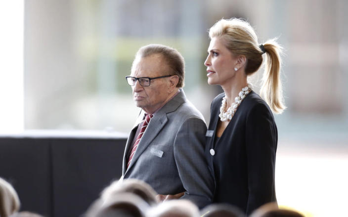 Larry King and his wife attend