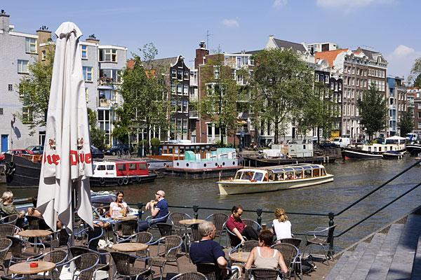 """<b>4. Netherlands</b> <br>Highest income tax rate: 52% <br> Average 2010 income: $57,000 <br><br>Holland's highest tax rate of 52 percent is much higher than the regional average of 45.7 percent in Western Europe.  <br><br>The country's top marginal tax rate kicks in at about $74,500 of taxable income. Annual property taxes generally range between $470 and $800. Other notable taxes include a capital gains tax of 25 percent, a land transfer tax of 6 percent and an inheritance tax that varies between 10 percent and 40 percent.  <br><br>The Netherlands, which has been in recession since July, <a href=""""http://www.reuters.com/article/2012/04/26/dutch-politics-budget-idUSL6E8FQI7D20120426"""">announced a budget deal</a> in April for 2013 that will freeze the incomes of civil servants for two years to save the government $3 billion by the end of 2013. Tax deductions for employee travel between work and home will also be reduced to save $1.58 billion, along with the raising of retirement age from 65 to 67 to grapple with the country's ballooning pension bill. Dutch government figures estimate that the overall effect of the tax increases and pay freeze will reduce consumer spending by 3 percent in 2013.  <br><br>Pictured: Amsterdam"""