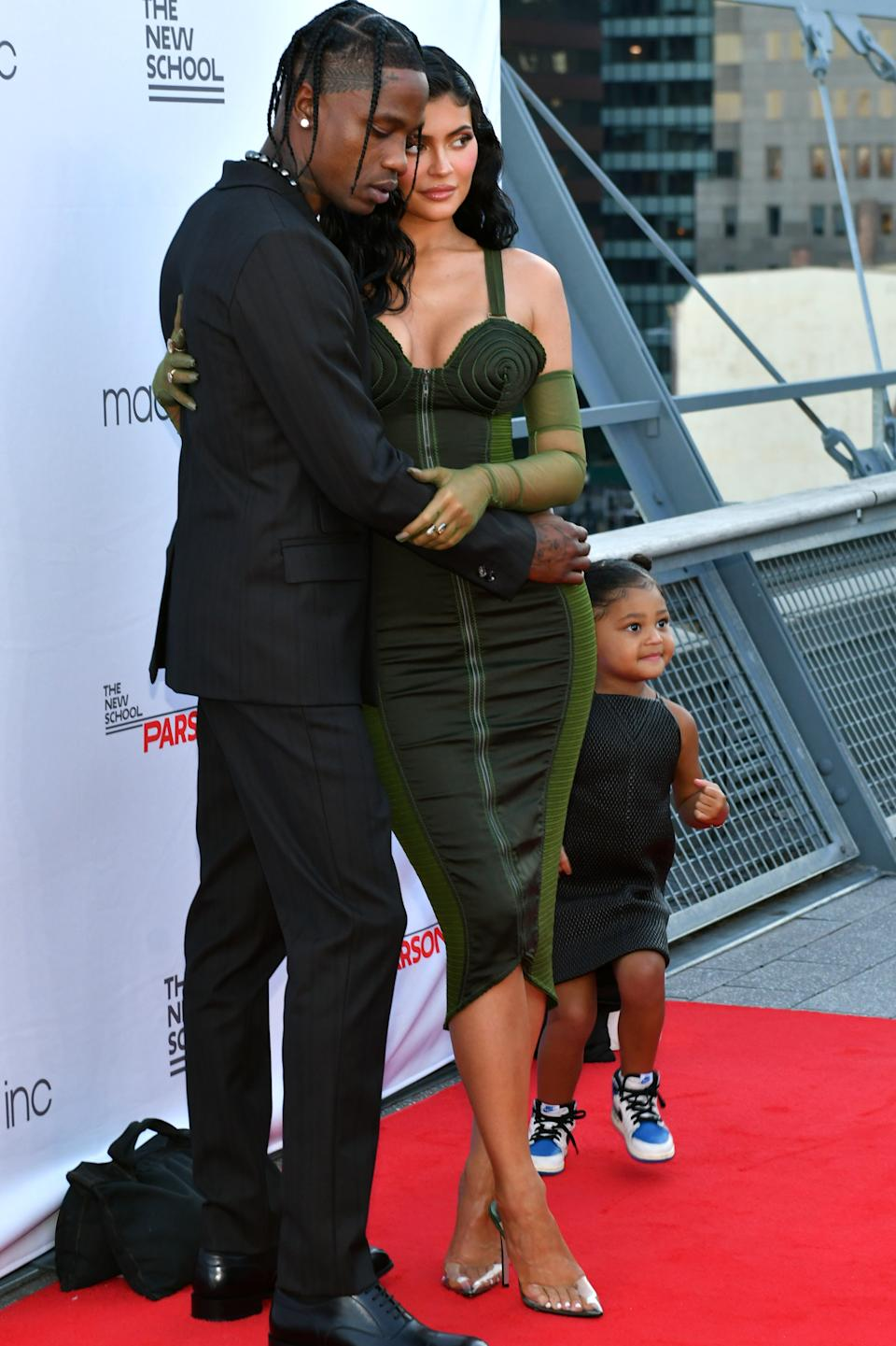 NEW YORK, NEW YORK - JUNE 15: Travis Scott, Kylie Jenner, and Stormi Webster attend the The 72nd Annual Parsons Benefit at Pier 17 on June 15, 2021 in New York City. (Photo by Craig Barritt/Getty Images for The New School)