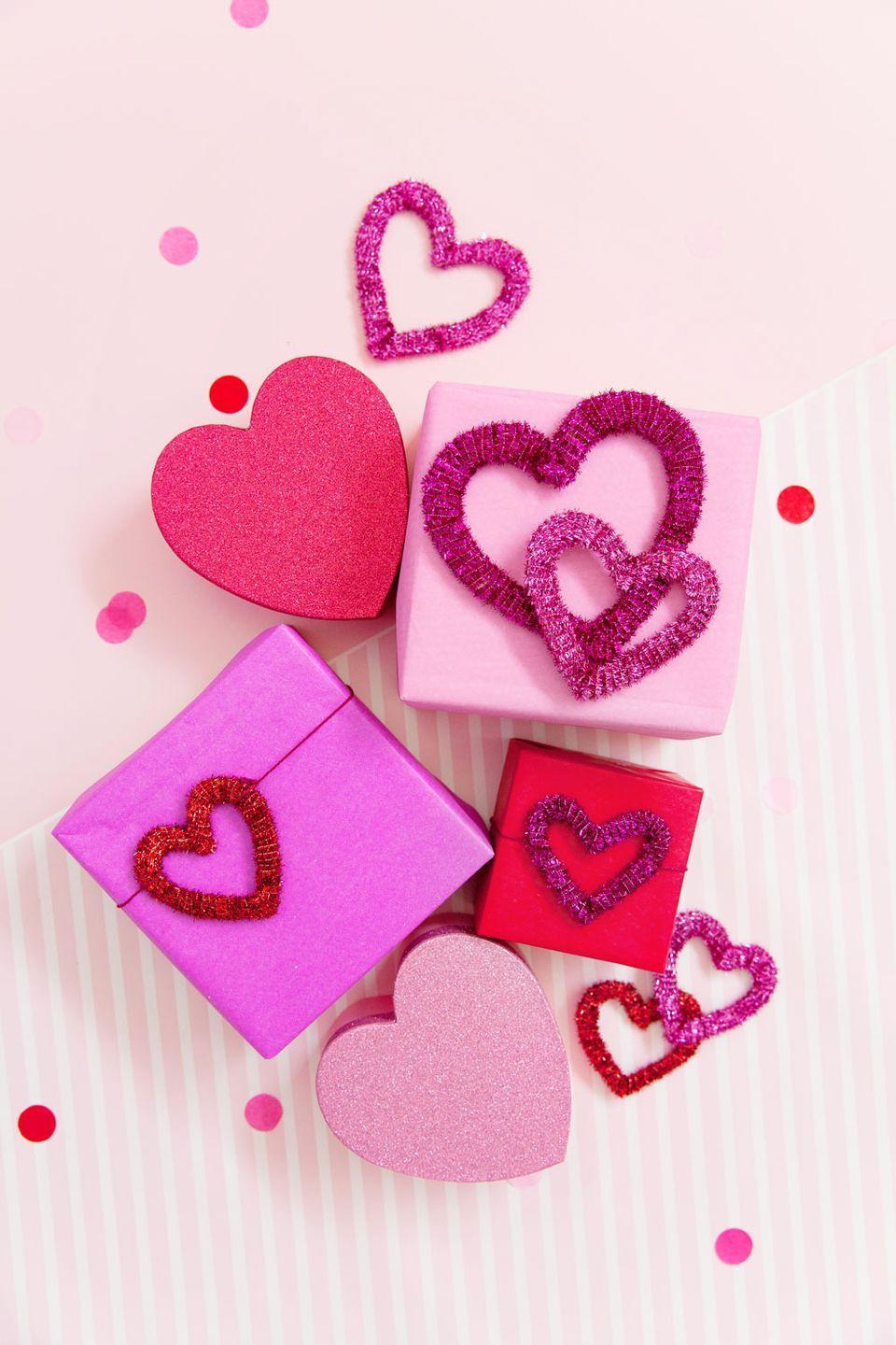 """<p>Once the make a batch of these sparkly hearts, the choice is yours: You can stick 'em on gifts, connect them as a garland, or use them to dress up your table. </p><p><em><a href=""""https://tellloveandparty.com/2018/01/diy-pipe-cleaner-hearts.html"""" rel=""""nofollow noopener"""" target=""""_blank"""" data-ylk=""""slk:Get the tutorial at Tell Love and Party »"""" class=""""link rapid-noclick-resp"""">Get the tutorial at Tell Love and Party »</a></em></p>"""