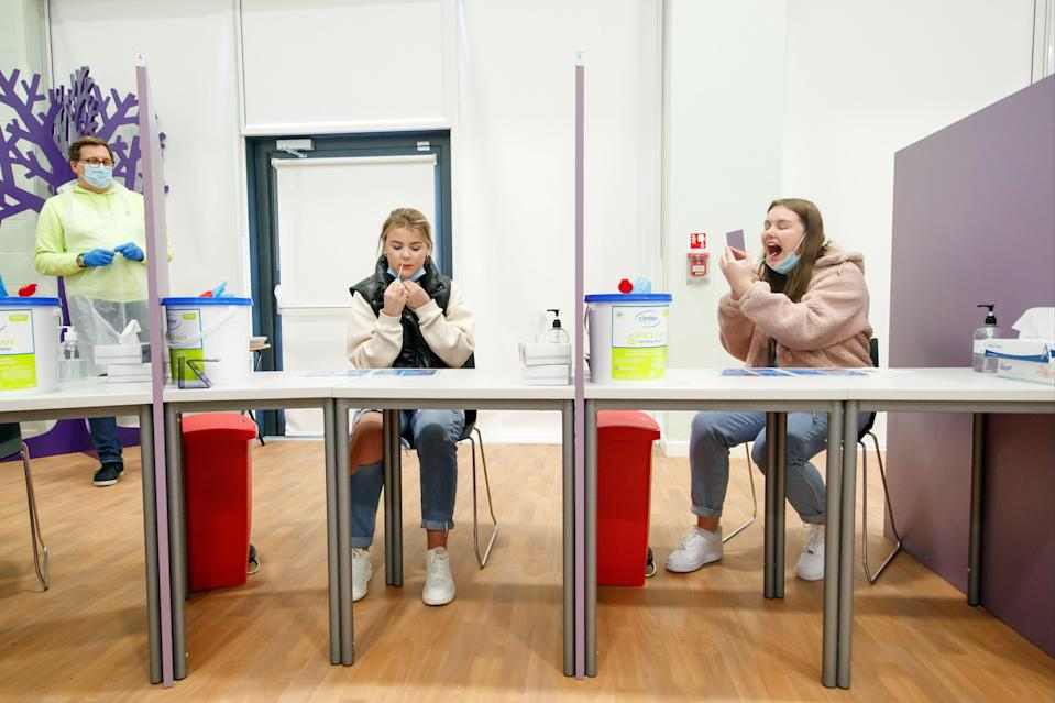 <p>Students take lateral flow tests at Outwood Academy Adwick in Doncaster, ahead of schools and colleges fully reopening on Monday</p> (PA)