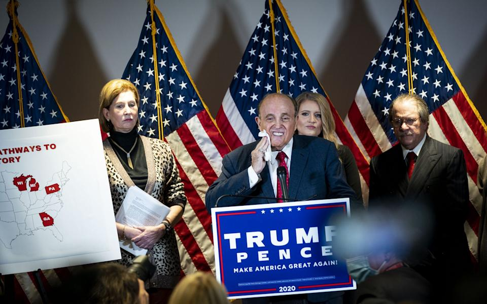 Rudy Giuliani, personal lawyer to Donald Trump, speaks at a news conference at the Republican National Committee headquarters in Washington on Thursday - Al Drago/Bloomberg