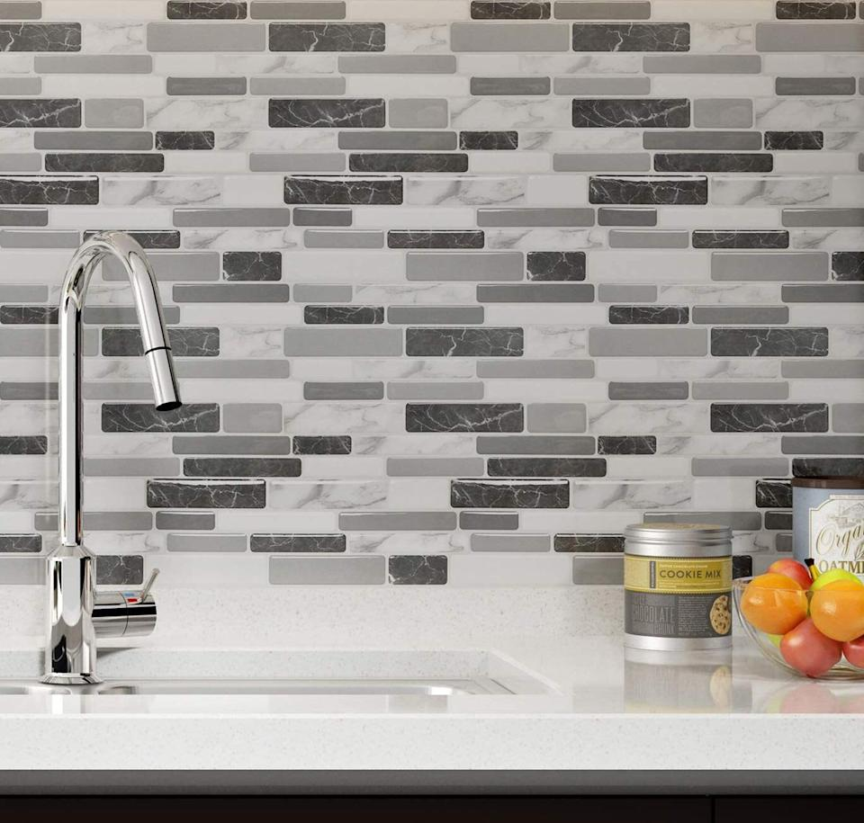 "Your kitchen will look so fresh that you might wonder if it's really the same one you've had for years. The peel-and-stick backsplash is also mold-, heat- and moisture-resistant.<br /><br /><strong>Promising review:</strong> ""We did a kitchen facelift this summer, repainting and making everything look fresh. We were looking at The Home Depot version of these, which are more than double the price. We decided to go for these instead and they are amazing!! I put them up myself in about two hours. I did buy the <a href=""https://amzn.to/3e6QOWN"" target=""_blank"" rel=""nofollow noopener noreferrer"" data-skimlinks-tracking=""5723569"" data-vars-affiliate=""Amazon"" data-vars-asin=""B000PCWRMC"" data-vars-href=""https://www.amazon.com/dp/B000PCWRMC?tag=bfjasmin-20&ascsubtag=5723569%2C15%2C31%2Cmobile_web%2C0%2C0%2C14870751"" data-vars-keywords=""cleaning"" data-vars-link-id=""14870751"" data-vars-price="""" data-vars-product-id=""18042766"" data-vars-product-img=""https://m.media-amazon.com/images/I/312Py9nshKL.jpg"" data-vars-product-title=""3M General Purpose 45 Spray Adhesive, 10-1/4-Ounce, White"" data-vars-retailers=""Amazon"">adhesive spray</a> just in case but it wasn't needed, even for the few I had to peel off and re-stick to center correctly. These aren't too difficult to apply but definitely require patience. 100% worth the buy for a DIY affordable update!"" — <a href=""https://amzn.to/3uXzQRn"" target=""_blank"" rel=""nofollow noopener noreferrer"" data-skimlinks-tracking=""5723569"" data-vars-affiliate=""Amazon"" data-vars-href=""https://www.amazon.com/gp/customer-reviews/R2K79UELAZILDG?tag=bfjasmin-20&ascsubtag=5723569%2C15%2C31%2Cmobile_web%2C0%2C0%2C14870767"" data-vars-keywords=""cleaning"" data-vars-link-id=""14870767"" data-vars-price="""" data-vars-product-id=""15955928"" data-vars-retailers=""Amazon"">Hope Consilvio</a><br /><br /><strong>Get a 10-pack from Amazon for <a href=""https://amzn.to/32lBeB3"" target=""_blank"" rel=""noopener noreferrer"">$35.99</a> (visit the <a href=""https://amzn.to/3eaV1Zy"" target=""_blank"" rel=""noopener noreferrer"">shop page</a> for more colors including a <a href=""https://amzn.to/3uRn72s"" target=""_blank"" rel=""noopener noreferrer"">multicolor</a> one, a <a href=""https://amzn.to/2RynkcA"" target=""_blank"" rel=""noopener noreferrer"">white marble</a> one and a <a href=""https://amzn.to/3uZiLXs"" target=""_blank"" rel=""noopener noreferrer"">brown</a> one).</strong>"