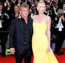 Sean Penn and Charlize Theron attend the Mad Max: Fury Road premiere during the 68th annual Cannes Film Festival on May 14.