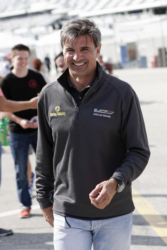 Three-time Rolex 24 Champion and retired driver Christian Fittipaldi walks through the garage area during testing for the upcoming Rolex 24 hour auto race at Daytona International Speedway, Friday, Jan. 3, 2020, in Daytona Beach, Fla. Fittipaldi will serve as the grand marshal for this years Rolex 24 auto race. (AP Photo/John Raoux)