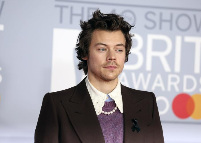 Harry Styles wore a black ribbon on his lapel in tribute to Caroline Flack (AP)
