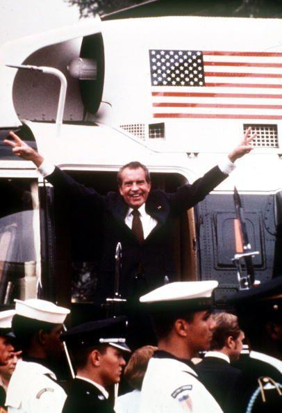 <p>1974. Getty Caption: President Richard Nixon of the United States gives the V-sign with both hands before boarding the Presidential helicopter to leave the White House for the last time after his resignation speech following the Watergate scandal </p>