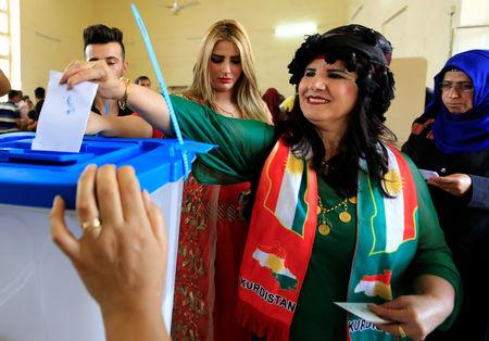 A woman casts her vote at a polling station during Kurds independence referendum in Kirkuk