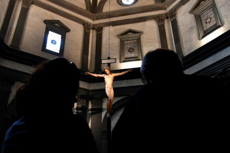 A wooden crucifix scupted by Michelangelo has been restored and returned to Florence's Santo Spirito church