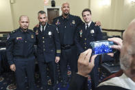 U.S. Capitol Police Sgt. Aquilino Gonell, from left, Washington Metropolitan Police Department officer Michael Fanone, U.S. Capitol Police Sgt. Harry Dunn and Washington Metropolitan Police Department officer Daniel Hodges, pose for a photo after testifying before the House select committee hearing on the Jan. 6 attack on Capitol Hill in Washington, Tuesday, July 27, 2021. (Chip Somodevilla/Pool via AP)