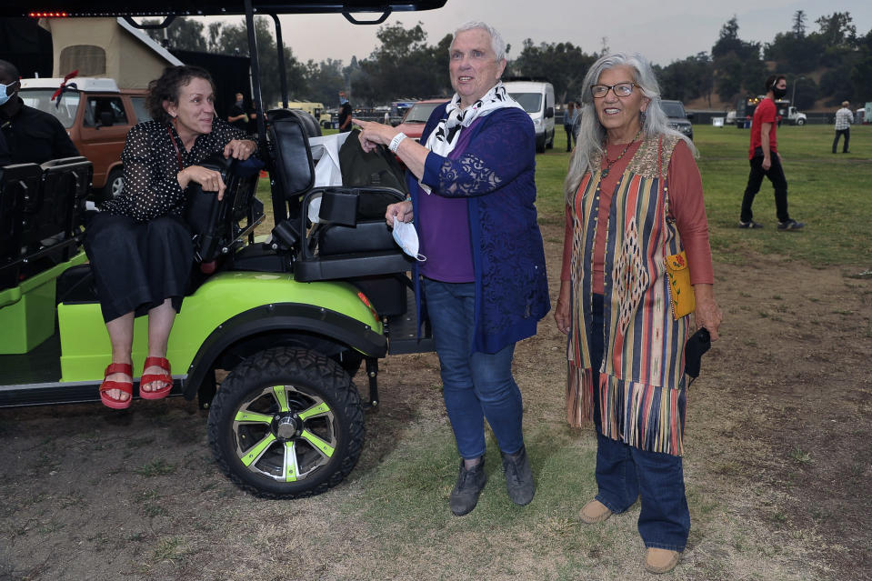 """Frances McDormand, from left, Swankie and Linda May attend the Telluride from Los Angeles drive-in screening of """"Nomadland"""" on Friday, Sept. 11, 2020, at the Rose Bowl in Pasadena, Calif. (Richard Shotwell/Invision/AP)"""