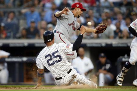 Jul 2, 2018; Bronx, NY, USA; New York Yankees second baseman Gleyber Torres (25) scores a run on wild pitch by Atlanta Braves third baseman Johan Camargo (17) during the third inning at Yankee Stadium. Mandatory Credit: Adam Hunger-USA TODAY Sports