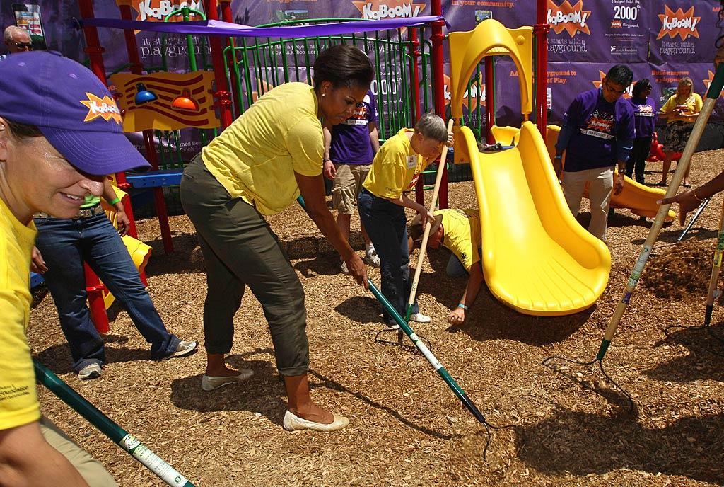 "First Lady Michelle Obama wasn't afraid to get her hands dirty on Wednesday when she took part in the construction of a 4,000-square-foot playground at the Imagine Southeast Public Charter Elementary School in Washington, D.C. She was there helping the non-profit organization KaBoom mark the building of its 2,000th playground! Win McNamee/<a href=""http://www.gettyimages.com/"" target=""new"">GettyImages.com</a> - June 15, 2011"