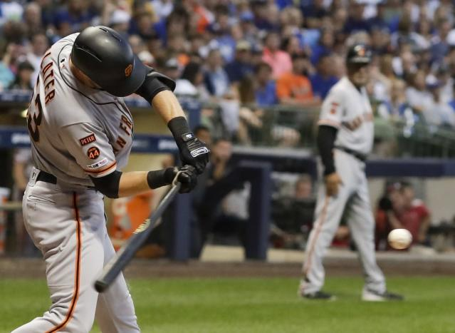 San Francisco Giants' Austin Slater hits a two-run home run during the fifth inning of a baseball game against the Milwaukee Brewers Friday, July 12, 2019, in Milwaukee. (AP Photo/Morry Gash)