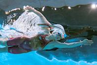 <p>An underwater view shows China's Li Bingjie competes to take bronze medal in the final of the women's 400m freestyle swimming event during the Tokyo 2020 Olympic Games at the Tokyo Aquatics Centre in Tokyo on July 26, 2021. (Photo by François-Xavier MARIT / AFP)</p>