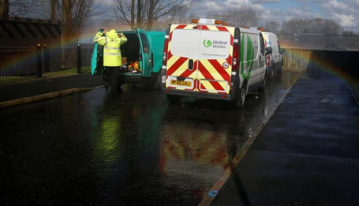 FILE PHOTO: A United Utilities engineer arrives at the scene of a burst water main