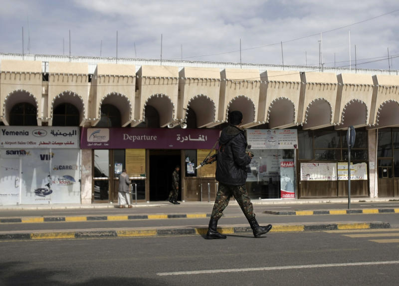 """A policeman walks as he secures the Sanaa International Airport, in Yemen, Wednesday, Aug. 7, 2013. The State Department on Tuesday ordered non-essential personnel at the U.S. Embassy in Yemen to leave the country. The department said in a travel warning that it had ordered the departure of non-emergency U.S. government personnel from Yemen """"due to the continued potential for terrorist attacks"""" and said U.S. citizens in Yemen should leave immediately because of an """"extremely high"""" security threat level. (AP Photo/Hani Mohammed)"""