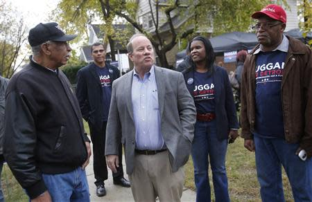 Mayoral candidate Mike Duggan (C) meets with supporters during a campaign stop in his childhood neighborhood in Detroit, Michigan November 2, 2013. REUTERS/Rebecca Cook