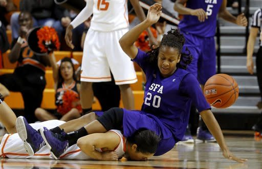 Stephen F. Austin's Antionette Carter (20) lands on top of Oklahoma State's Brittney Martin (22) during their NCAA college basketball game, Thursday, Dec. 6, 2012, in Stillwater, Okla. (AP Photo/The Oklahoman, Bryan Terry)