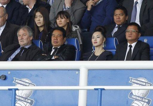 File photo of Birmingham City owner Carson Yeung (2nd L) watches the team play at St. Andrews in Birmingham. Yeung took control of Birmingham City in October 2009 in an £81 million ($130 million) takeover from David Sullivan and David Gold, now the co-owners of West Ham