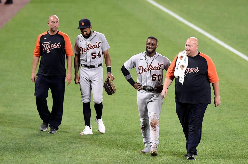 Tigers center fielder Derek Hill and left fielder Akil Baddoo come out of the game after colliding with each other in the eighth inning of the 9-4 win over the Orioles on Tuesday, Aug. 10, 2021, in Baltimore.