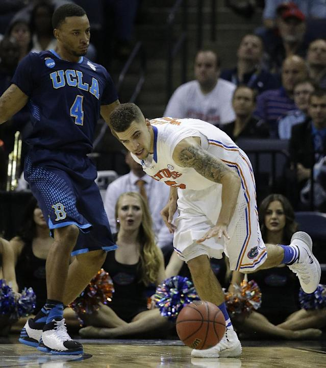 Florida guard Scottie Wilbekin (5) moves the ball against UCLA guard Norman Powell (4) during the second half in a regional semifinal game at the NCAA college basketball tournament, Thursday, March 27, 2014, in Memphis, Tenn. (AP Photo/Mark Humphrey)