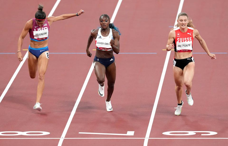 Great Britain's Dina Asher-Smith (centre) struggles during the women's 100 metres semi-finals. (PA Wire)
