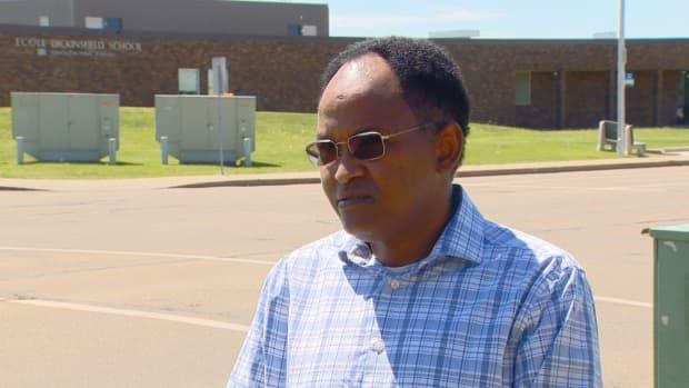Jibril Ibrahim, president of the Somali Canadian Cultural Society (SCCS), says the Edmonton woman from his community, who is in her 50s, was grabbed by her neck and pushed down to the sidewalk on Friday while she was out for a walk.    (Scott Neufeld/CBC - image credit)