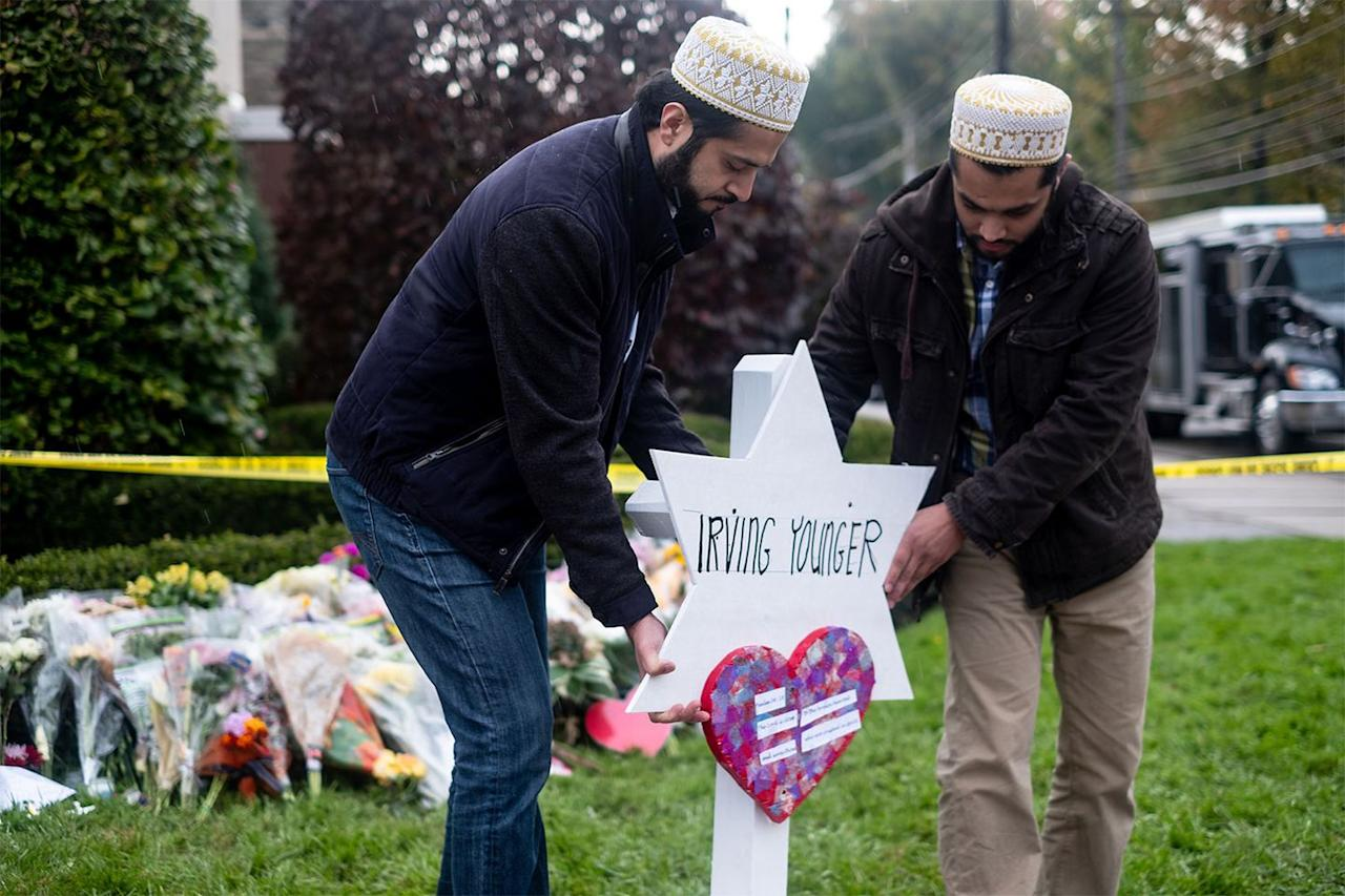 "<p>Two members of the Muslim community set up a temporary grave site for one of the victims of the Tree of Life synagogue shooting in Pittsburgh, Pennsylvania. Muslim organizations <a rel=""nofollow"" href=""https://www.cnn.com/2018/10/29/us/iyw-muslim-crowdfunding-for-synagogue-victims-trnd/index.html"">raised over $200,000</a> to support families of the victims in the days following the shooting on October 27, 2018.</p>"