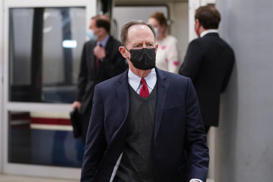 Sen. Pat Toomey, R-Pa., walks on Capitol Hill in Washington, Saturday, Feb. 13, 2021, on the fifth day of the second impeachment trial of former President Donald Trump. (AP Photo/Alex Brandon)