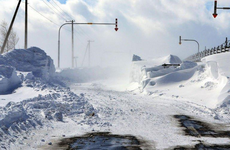 A road on Hokkaido island is seen covered in snow on March 3, 2013 after severe weekend blizzards sweep northern Japan