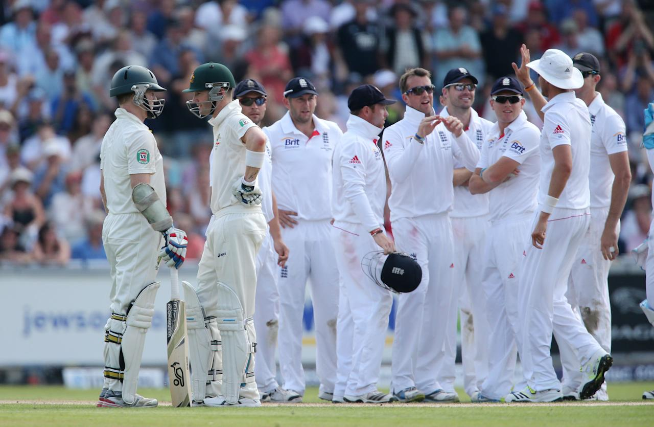 Australia batsman Chris Rogers (left) speaks to his captain Michael Clarke after he was out for 84 trapped out LBW by England bowler Graeme Swann during day one of the Third Investec Ashes test match at Old Trafford Cricket Ground, Manchester.
