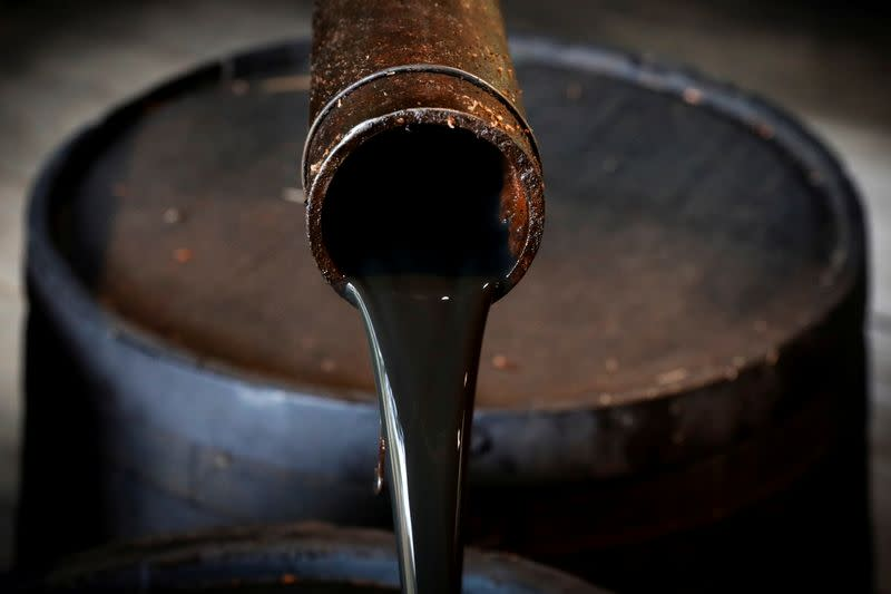 FILE PHOTO: Oil pours out of a spout from Edwin Drake's original 1859 well that launched the modern petroleum industry at the Drake Well Museum and Park in Titusville, Pennsylvania