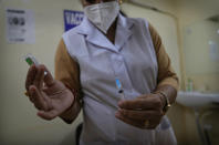 A health worker prepares to administer the Covishield vaccine for COVID-19 at a government hospital in New Delhi, India, Tuesday, Sept. 21, 2021. Travelers and authorities from India and many African countries are furious and confused about Britain's new COVID-19 travel rules, calling them discriminatory, as experts warn the measures could fuel misinformation about vaccines in countries in some of the world's least vaccinated countries. (AP Photo/Manish Swarup)