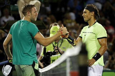 Mar 29, 2017; Miami, FL, USA; Rafael Nadal of Spain (R) shakes hands with Jack Sock of the United States (L) after their match on day nine of the 2017 Miami Open at Crandon Park Tennis Center. Nadal won 6-2, 6-3. Mandatory Credit: Geoff Burke-USA TODAY Sports