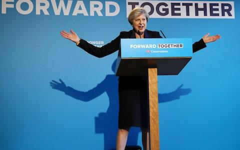 Theresa May launching the Conservative manifesto in May - Credit:  Dan Kitwood