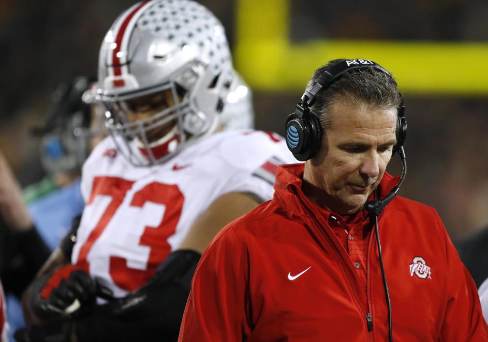 Ohio State head coach Urban Meyer, right, reacts during the Buckeyes' blowout loss to Iowa on Saturday. (AP)