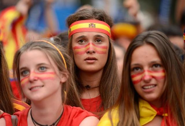 Supporters of the Spanish national football team react while watching the Euro 2012 Championships football match between Spain and Croatia on June 18, 2012 on a giant screen near the Santiago Bernabeu Stadium in Madrid. AFP PHOTO/ DANI POZODANI POZO/AFP/GettyImages