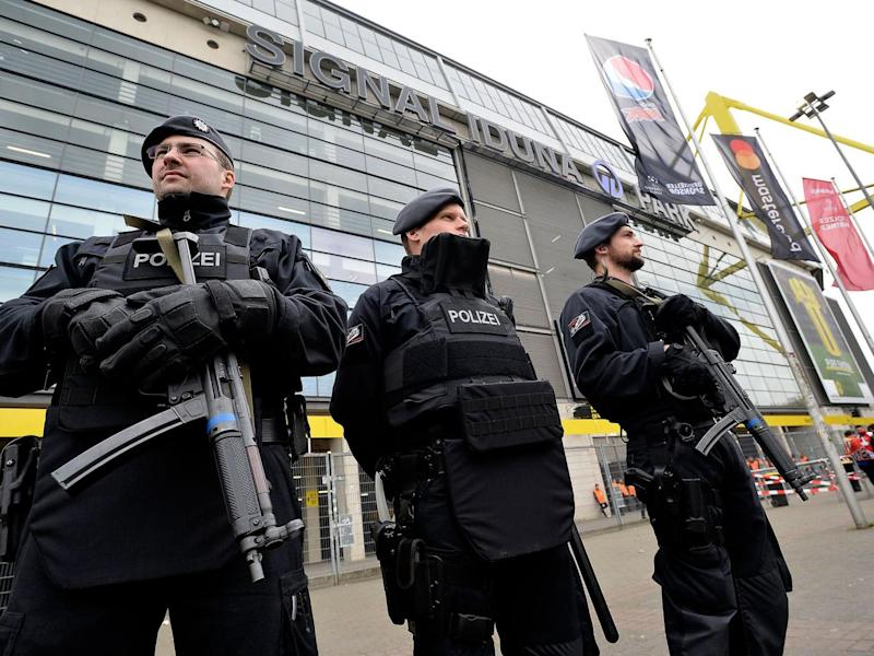 Officers secure Borussia Dortmund's stadium ahead of the Champions League tie (EPA)