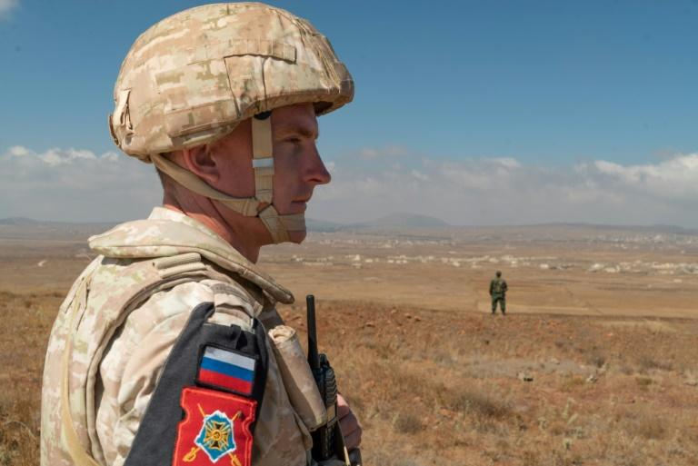 A member of the Russian military police patrols near the village of Tal Krum in the Syrian Golan Heights on August 14, 2018