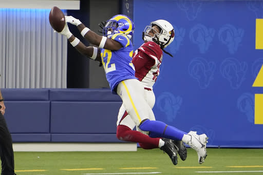 Los Angeles Rams strong safety Jordan Fuller, left, breaks up a pass intended for Arizona Cardinals wide receiver DeAndre Hopkins during the second half of an NFL football game in Inglewood, Calif., Sunday, Jan. 3, 2021. (AP Photo/Jae C. Hong)