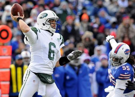 New York Jets' Sanchez is back to pass against Buffalo Bills' Sheppard in their NFL football game in Orchard Park