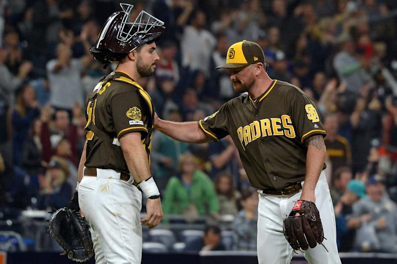 May 31, 2019; San Diego, CA, USA; San Diego Padres relief pitcher Kirby Yates (right) and catcher Austin Hedges (18) celebrate a 5-2 win over the Miami Marlins at Petco Park. Mandatory Credit: Jake Roth-USA TODAY Sports