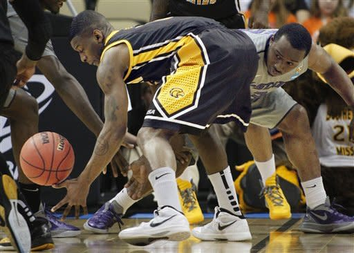 Southern Mississippi's Neil Watson, left, and Kansas State's Martavious Irving reach for a loose ball in the first half of an East Regional NCAA tournament second-round college basketball game on Thursday, March 15, 2012, in Pittsburgh. (AP Photo/Keith Srakocic)