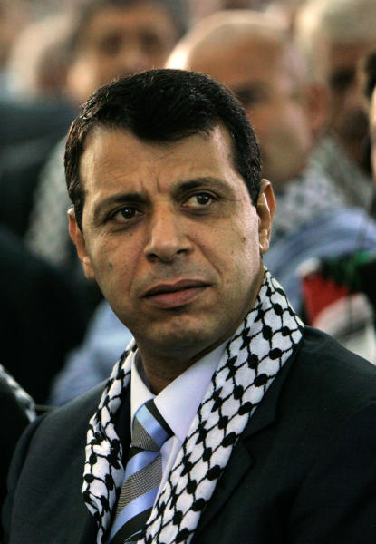 FILE - In this Aug. 4, 2009 file photo, then Fatah leader Mohammed Dahlan listens to a speech during a Fatah conference in the West Bank town of Bethlehem. The exiled Palestinian politician who quietly negotiated a power-sharing deal for Gaza with former arch foe Hamas discussed the details for the first time in an interview, saying he expects the understandings to lead to a swift opening of the blockaded territory's border with Egypt and ease crippling power shortages. (AP Photo/Tara Todras-Whitehill, File)