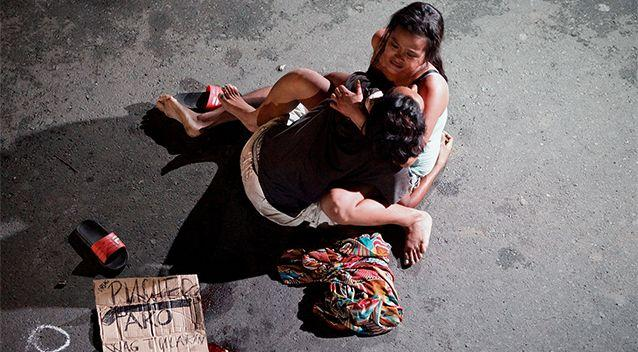 Jennelyn Olaires, 26, cradles the body of her partner, who was killed on a street by a vigilante group, according to police, in a spate of drug related killings in Pasay city. Photo: Reuters/Czar Dancel