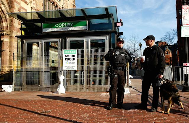 BOSTON, MA - APRIL 21: Police officers and a K-9 unit patrol Boylston Street next to the closed down MBTA Copley station prior to the start of the 2014 B.A.A. Boston Marathon on April 21, 2014 in Boston, Massachusetts. Today marks the 118th Boston Marathon; security presence has been increased this year, due to two bombs that were detonated at the finish line last year, killing three people and injuring more than 260 others. (Photo by Jared Wickerham/Getty Images)